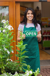 Woman holding open business sign